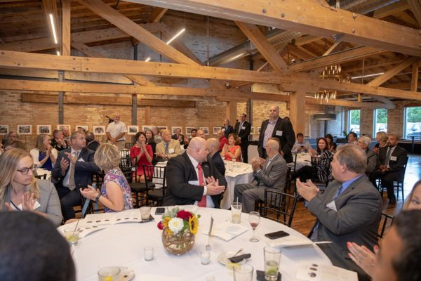 Finalists of the 2018 governor's energy excellence awards stand for applause